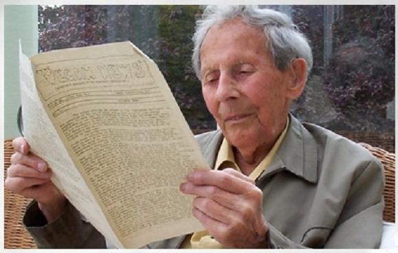 """Donald Watson čita prvo izdanje tromjesečnog biltena Veganskog društva: """"Veganske vijesti (The Vegan News)"""""""